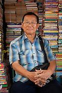 A man selling second hand books at Chatuchak JJ market in Bangkok, Thailand