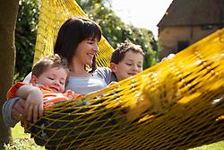 Woman and Children on Hammock