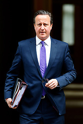 © Licensed to London News Pictures. 10/06/2015. London, UK. British Prime Minister DAVID CAMERON leaving Number 10, Downing Street to attend the Prime Minister's Questions at Parliament on Wednesday, 10 June 2015. Photo credit: Tolga Akmen/LNP
