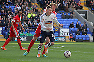 Bolton's  Joe Mason makes a break. Skybet championship match, Bolton Wanderers v Blackburn Rovers at the Reebok Stadium in Bolton, England on Saturday 1st March 2014.<br /> pic by David Richards, Andrew Orchard sports photography.