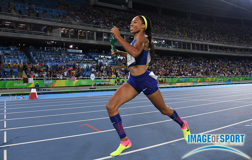 Aug 18, 2016; Rio de Janeiro, Brazil; Allyson Felix celebrates after running the anchor leg on the United States women's 4 x 400m relay that won in 3:19.06 during the 2016 Rio Olympics at Estadio Olimpico Joao Havelange. <br /> <br /> *