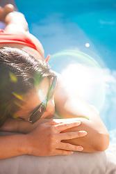 Woman Lying on Swimming Pool Edge