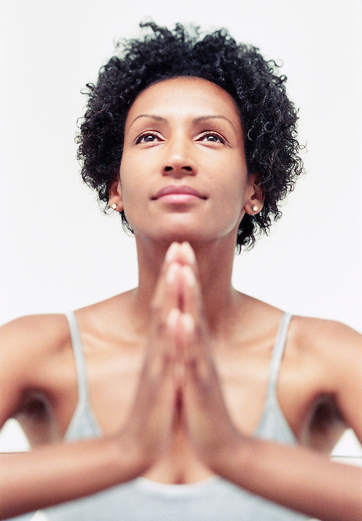 An woman during a meditation / yoga session at Club Zum, Seattle, Washington, USA.