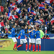PARIS, FRANCE - March 25:  Supporter celebrate a goal from Samuel Umtiti #5 of France as he is congratulated by team mates during the France V Iceland, 2020 European Championship Qualifying, Group Stage at  Stade de France on March 25th 2019 in Paris, France (Photo by Tim Clayton/Corbis via Getty Images)