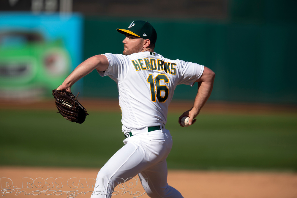 Oakland Athletics pitcher Liam Hendriks (16) delivers against the Texas Rangers during the ninth inning of a baseball game, Sunday, Sept. 22, 2019, in Oakland, Calif. (AP Photo/D. Ross Cameron)