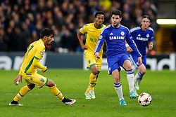 Cesc Fabregas of Chelsea passes back as Joao Mario of Sporting challenges - Photo mandatory by-line: Rogan Thomson/JMP - 07966 386802 - 10/12/2014 - SPORT - FOOTBALL - London, England - Stamford Bridge - Sporting Clube de Portugal - UEFA Champions League Group G.