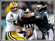 Philadelphia's Darwin Walker sacks Green Bay's Brett Favre for a 8-yard loss in the 2nd quarter. Walker shared the sack with Corey Simon. .The Green Bay Packers traveled to Lincoln Financial Field in Philadelphia to play the Eagles Sunday, December 5, 2004. WSJ/Steve Apps.