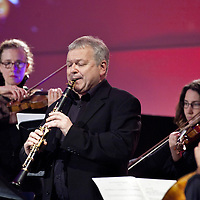 Picture Shows :  <br /> City of London Sinfonia Principal Conductor and Clarinettist Michael Collins.<br /> Performing -<br /> Gwilym Simcock: On a piece of tapestry for clarinet, speaker, jazz trio & strings<br /> <br /> A new COMMISSION fusing the worlds of classical music and jazz.<br /> <br /> This distinctive new work for clarinet, strings, jazz trio and speaker celebrates the virtuosity of City of London Sinfonia Principal Conductor and Clarinettist Michael Collins.<br /> <br /> The project brings together some of the UK's most exceptional musical talents.<br /> <br /> Part of 'Beyond the Premiere' series with Orchestras Live. Additional support from RVW Trust.<br /> <br /> NEW MUSIC BIENNIAL 2014 <br /> GLASGOW ROYAL CONCERT HALL<br /> 1st – 2nd August 2014<br /> <br /> New Music Biennial is a PRS for Music Foundation initiative, in partnership with Creative Scotland, Arts Council England and the British Council. It is presented in collaboration with BBC Radio 3, NMC Recordings, Southbank Centre and Glasgow UNESCO City of Music.<br /> <br /> The New Music Biennial is an international celebration - part of Glasgow Culture 2014, the cultural programme of the Commonwealth Games.<br /> <br /> PRS for Music Foundation is the UK's leading charitable funder of new music across all genres. Since 2000 PRS for Music Foundation has given more than £19 million to over 4500 new music initiatives by awarding grants and leading partnership programmes that support music sector development. <br /> <br /> Picture Drew Farrell<br /> Tel : 07721-735041<br /> <br /> For Further information please contact :<br /> Liam McMahon ( Comms Manager)<br /> Tel : 020 7580 5544