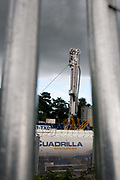 Balcombe, West Sussex. Site of Cuadrilla drilling, the drilling rig seen through the fence.