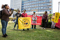 London, UK. 1 June, 2019. Dalia Quinonez Guerrero, a cleaner who worked at the DoubleTree Hilton Hotel for six months but from whom wages were withheld, addresses members of the United Voices of the World (UVW) grassroots trade union in advance of a protest inside the hotel in solidarity with her. The protest was previously arranged to have taken place outside Chanel but arrangements were changed after the global fashion chain agreed to pay its cleaners the London Living Wage at its stores.