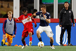 September 22, 2018 - Foxborough, MA, U.S. - FOXBOROUGH, MA - SEPTEMBER 22: New England Revolution defender Antonio Mlinar Delamea (19) breaks in front of Chicago Fire midfielder Raheem Edwards (7) during a match between the New England Revolution and the Chicago Fire on September 22, 2018, at Gillette Stadium in Foxborough, Massachusetts. The teams played to a 2-2 draw. (Photo by Fred Kfoury III/Icon Sportswire) (Credit Image: © Fred Kfoury Iii/Icon SMI via ZUMA Press)