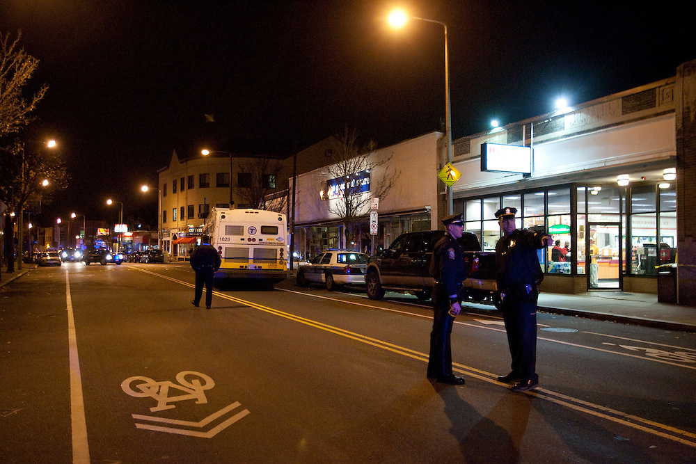 Boston, MA 11/21/2010.Centre St. in Jamaica Plain is shut down as Boston Police officers investigate a fatal shooting inside the Same Old Place restaurant on Sunday evening..Alex Jones / www.alexjonesphoto.com