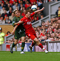 John Arne Riise Liverpool/ Paul McVeigh Norwich City<br />Liverpool v Norwich City 25/09/04<br />The Premier League<br />Photo Robin Parker