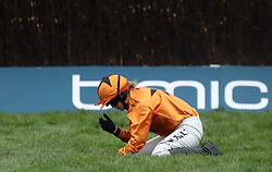 Jockey Lizzie Kelly after a fall on Tea For Two in the Timico Cheltenham Gold Cup Chase during Gold Cup Day of the 2017 Cheltenham Festival at Cheltenham Racecourse.