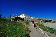 Image of a woman hiking at Mount Hood, Oregon, near Timberline Lodge, Pacific Northwest by Andrea Wells