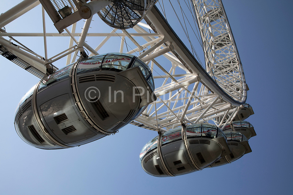 Pods on the London Eye in London, England, United Kingdom. The London Eye is a giant Ferris wheel on the South Bank. Also known as the Millennium Wheel, its official name was originally the British Airways London Eye, then the Merlin Entertainments London Eye, the EDF Energy London Eye and now the Coca Cola London Eye.