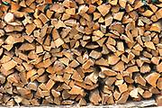 Firewood for cooking stacked outside a house. San Juan la Laguna. Departamente de Sololá, Republic of Guatemala. 06Mar14