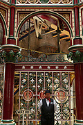 A guide dressed in a Victorian suit stands next to a Way Out sign at Crossness Pumping Station on the 22nd September 2019 in London in the United Kingdom. Built by Sir Joseph Bazalgette for Londons sewage system and opened in 1865, Crossness Pumping Station is a Grade 1 Listed building.