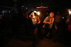 May 25, 2017 - Lalitpur, Nepal - A Nepalese devotee carries a traditional torch during a procession to welcome the deity back to the temple on the last day of the month-long Rato Machindranath festival in Lalitpur, Nepal on May 25, 2017. (Credit Image: © Skanda Gautam via ZUMA Wire)