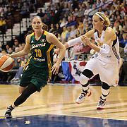 Sue Bird, Seattle Storm, dribbles past Katie Douglas, Connecticut Sun, during the Connecticut Sun Vs Seattle Storm WNBA regular season game at Mohegan Sun Arena, Uncasville, Connecticut, USA. 23rd May 2014. Photo Tim Clayton