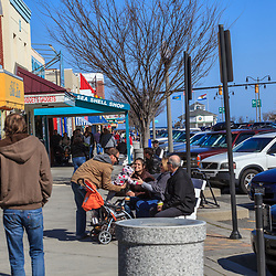 Rehoboth Beach, DE, USA - March 11, 2012: People are walking in Delaware's Rehoboth Beach in early spring.