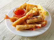 Oriental selection with bread coated and battered prawns, spring rolls,  dim sum & samosas with a chilli  dipping sauce