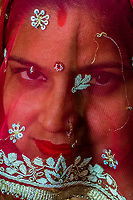 A veiled woman, Chhadi Mar Holi (local Holi celebration), Holi Festival (Festival of Colors), village of Gokul, near Mathura, Uttar Pradesh, India.