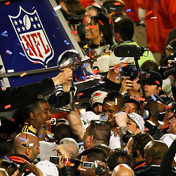 2010 February 07: New Orleans Saints head coach hands off the Vince Lombardi Trophy to players as they celebrate following a 31-17 win by the New Orleans Saints over the Indianapolis Colts in Super Bowl XLIV at Sun Life Stadium in Miami, Florida.