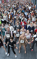 © Licensed to London News Pictures. 11/10/2015. London, UK. 977 volunteers attempt to break the world record for the largest number of people dancing the Charleston at Spitalfields. The previous record was acheived with 503 dancers.  Photo credit: Peter Macdiarmid/LNP