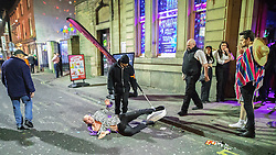 © Licensed to London News Pictures . 27/12/2016 . Wigan , UK . Doormen ejects a man from Reflex nightclub . Revellers in Wigan enjoy Boxing Day drinks and clubbing in Wigan Wallgate . In recent years a tradition has been established in which people go out wearing fancy-dress costumes on Boxing Day night . Photo credit : Joel Goodman/LNP