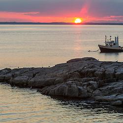 Fishing boat at sunset. Appledore Island, Maine.