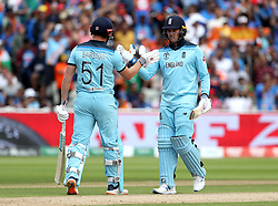 England's Jonny Bairstow (left) with team-mate Jason Roy (right) after reaching fifty runs during the ICC Cricket World Cup group stage match at Edgbaston, Birmingham.