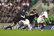 Twickenham. Surrey. UK England vs New Zealand, Autumn Internationals.<br /> Matt DAWSON tackled by Marty HOLAH [Spear Tackle]<br /> 09/11/2002<br /> International Rugby England vs New Zealand