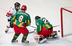 Marius Gohringer of Austria vs goalkeeper of Lithuania Mantas Armalis  during the ice hockey match between National teams of Lithuania (LTU) and Austria (AUT) at 2011 IIHF World U20 Championship Division I - Group B, on December 12, 2010 in Ice skating Arena, Bled, Slovenia.  (Photo By Vid Ponikvar / Sportida.com)