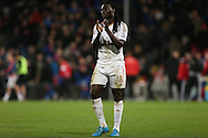 Bafetimbi Gomis of Swansea City applauding the Swansea City away fans after the final whistle. Barclays Premier League match, Crystal Palace v Swansea city at Selhurst Park in London on Monday 28th December 2015.<br /> pic by John Patrick Fletcher, Andrew Orchard sports photography.