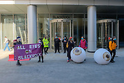 Environmental activist group Extinction Rebellion are seen holding banners and a giant inflatable set of eyes outside Blackrock HQ in London on Friday, April 16, 2021 -  demanding that the company upholds their promise to take action on climate change. Blackrock is the world's largest investor in fossil fuels. (VXP Photo/ João Daniel Pereira)