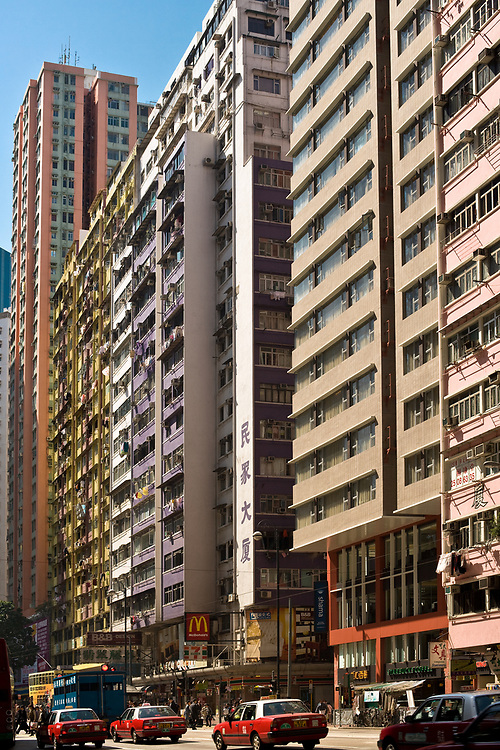 Pak Kok (North point) district, Hong Kong Island, Hong Kong, China, Asia - Residential apartment buildings at King's Road on Fortress Hill with the street full of traditional red taxi.