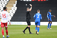 Carlisle United defender George Tanner (2) is shown a yellow card, booked by Referee Brett Huxtable during the EFL Sky Bet League 2 match between Stevenage and Carlisle United at the Lamex Stadium, Stevenage, England on 20 March 2021.