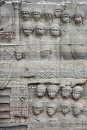 Close-up view of the marble pedestal which supports the obelisk of Theodosius I, a tourist attraction located outdoors at the Hippodrome in Istanbul, Turkey. The bas-reliefs, here showing the emperor and his court, date to the time of the obelisk's re-erection in Constantinople in the 4th century.