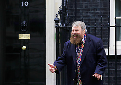 © Licensed to London News Pictures 24/04/2013.Actor Brian Blessed shares a joke with photographers outside Downing Street, after joining NAVS (National Anti-Vivisection Society) in delivering a petition, calling for less secrecy in animal laboratories, on World Day for Laboratory Animals..London, UK.Photo credit: Anna Branthwaite/LNP