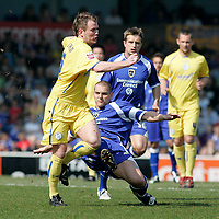 Photo: Mike Greenslade..Cardiff City v Sheffield Wednesday..Coca Cola Championship League..07.04.07..Ninian Park..KO Cardiff's Darren Purse clears from Steve Watson