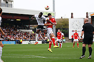 Port Vale's Jordan Slew (l) and Crewe Alexandra's Liam Nolan jump for the ball. Skybet football league one match, Crewe Alexandra v Port Vale at the Alexandra Stadium in Crewe on Saturday 13th Sept 2014.<br /> pic by Chris Stading, Andrew Orchard sports photography.