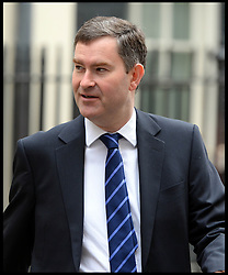 Exchequer Secretary to the Treasury David Gauke  leaves No10 Downing after the Budget Cabinet meeting and just before The Chancellor George Osborne poses on the steps of No11 Downing street with his red budget box for the 2014 Budget, London, United Kingdom. Wednesday, 19th March 2014. Picture by Andrew Parsons / i-Images