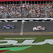 NASCAR Spring Cup driver Aric Almirola (43) leads Brian Vickers (55) during the 56th Annual NASCAR Coke Zero 400 race at Daytona International Speedway on Sunday, July 6, 2014 in Daytona Beach, Florida.  (AP Photo/Alex Menendez)