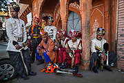 Musicians of the Hindu Jea Band of Jaipur waiting for their bus on 4th February 2018 in Jaipur, Rajasthan, India. Established in 1934 this 20-member band band has the distinction of playing at most important events on Rajasthan calendar.
