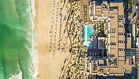 Aerial view of resort and beach on Pearl Jumeirah island in Dubai, U.A.E.