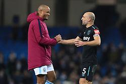 Manchester City's Vincent Kompany (left) West Ham United's Pablo Zabaleta after the final whistle