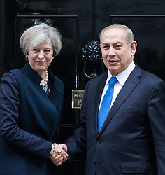 Downing Street, London, February 6th 2017. Israeli Prime Minister Benjamin Netanyahu arrives at 10 Downing Street for lunchtime talks with British Prime Minister Theresa May, with some confusion arising when Mrs May was not immediately on hand to welcome him. Minutes later the two PMs emerged for the traditional handshake photographs at the door of No 10. PICTURED: Theresa May and Benjamin Netanyahu shake hands at the door of 10 Downing Street.