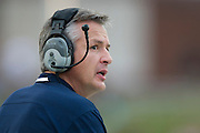 DALLAS, TX - NOVEMBER 16: Connecticut Huskies head coach T.J. Weist looks on against the SMU Mustangs on November 16, 2013 at Gerald J. Ford Stadium in Dallas, Texas.  (Photo by Cooper Neill/Getty Images) *** Local Caption *** T.J. Weist