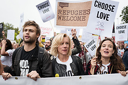 © Licensed to London News Pictures. 17/09/2016. London, UK. Actor DOUGLAS BOOTH (L) and actress JULIET STEVENSON (centre) join thousands march through central London to call on the government to welcome refugees to the UK. Photo credit: Rob Pinney/LNP